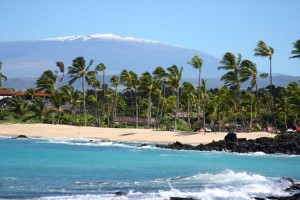 Beach with snow capped Maunakea