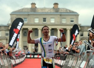 LICHFIELD, ENGLAND - JUNE 14:  Markus Thomschke of Germany celebrates finishing second in the mens race at Ironman 70.3 Staffordshire on June 14, 2015 in Lichfield, England.  (Photo by Nigel Roddis/Getty Images for Ironman)