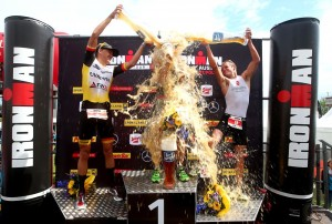 ST POLTEN, AUSTRIA - MAY 17: Nils Frommhold of Germany (L) and Jan van Berkel of Switzerland (R) shower winner Andreas Bocherer of Germany (C) with beer during the Ironman 70.3: St. Polten on May 17, 2015 in St Polten, Austria. (Photo by Charlie Crowhurst/Getty Images for Ironman) *** Local