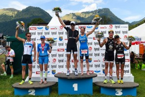 WALCHSEE, AUSTRIA - AUGUST 23: Men and Women medalist celebrate during the podium ceremony of the Challenge Triathlon Walchsee-Kaiserwinkl on August 23, 2015 in Walchsee, Austria.  (Photo by David Ramos/Getty Images for Challenge Triathlons)