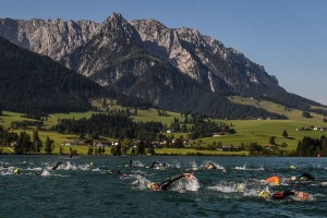 WALCHSEE, AUSTRIA - AUGUST 23: Participants take part in theswim leg of the race during the Challenge Triathlon Walchsee-Kaiserwinkl on August 23, 2015 in Walchsee, Austria. (Photo by David Ramos/Getty Images for Challenge Triathlons)