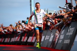 PEMBROKE, WALES - SEPTEMBER 13: Markus Thomschke of Germany celebrates as he crosses the line to come third during Ironman Wales on September 13, 2015 in Pembroke, Wales. (Photo by Jordan Mansfield/Getty Images for Ironman)