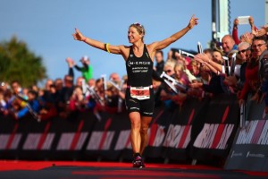 PEMBROKE, WALES - SEPTEMBER 13:  Anja Beranek of Germany celebrates as she crosses the line to win the Ironman Wales on September 13, 2015 in Pembroke, Wales.  (Photo by Jordan Mansfield/Getty Images for Ironman)