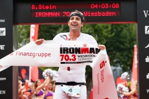 WIESBADEN, GERMANY - AUGUST 09: Boris Stein of Germany celebrates winning the Wiesbaden Ironman 70.3 on August 9, 2015 in Wiesbaden, Germany.  (Photo by Harry Engels/Getty Images for Ironman)