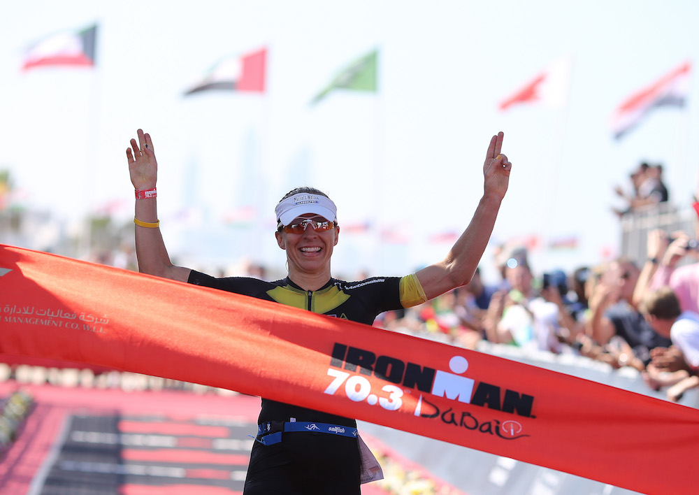 DUBAI, UNITED ARAB EMIRATES - FEBRUARY 02: Anne Haug of Germany celebrates winning the women's race Ironman 70.3 Dubai on February 2, 2018 in Dubai, United Arab Emirates. (Photo by Nigel Roddis/Getty Images)