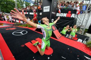 KLAGENFURT, AUSTRIA - JUNE 26: Marino Vanhoenacker of Belguim celebrates winning Ironman Austria on June 26, 2016 in Klagenfurt, Austria. (Photo by Nigel Roddis/Getty Images for Ironman)