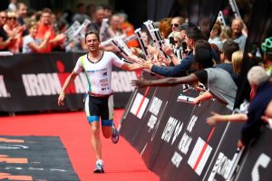 BOLTON, ENGLAND - JULY 17: Markus Thomschke of Germnay crosses the line to finish second in the mens race during the Ironman UK on July 17, 2016 in Bolton, England. (Photo by Charlie Crowhurst/Getty Images)