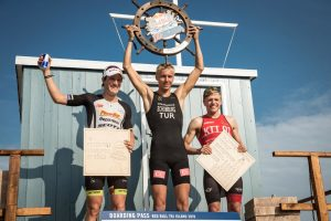 Winners Sebastian Kinle(left) Jonas Sschomburg(middle) and Robert Skazidroga(right) celebrating on the podium at the Red Bull Tri Islands in Sylt, Germany on July 23, 2016