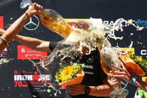 KRAICHGAU, GERMANY - JUNE 11: Sebastian Kienle of Germany gets a beer shower winning Ironman 70.3 Kraichgau on June 11, 2017 in Kraichgau, Germany. (Photo by Joern Pollex/Getty Images)