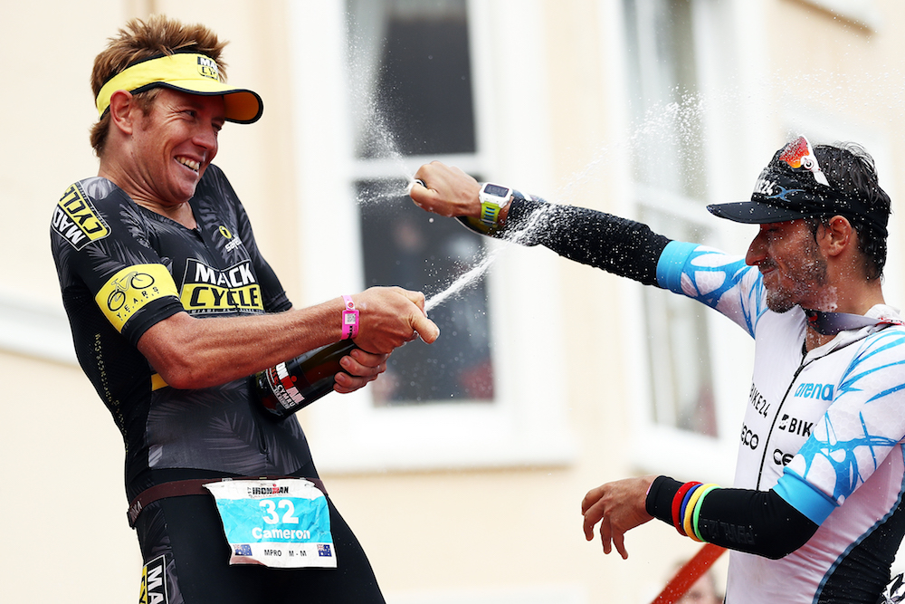 Cameron Wurf of Australia celebrates winning with the German Christian Kramer. IRONMAN Wales on September 10, 2017 in Tenby, Wales. (Photo by Bryn Lennon/Getty Images for IRONMAN)