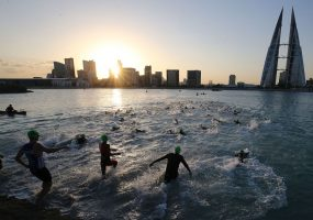BAHRAIN, BAHRAIN - NOVEMBER 25: Athletes compete in the swim section of the Ironman 70.3 Middle East Championship Bahrain on November 25, 2017 in Bahrain, Bahrain. (Photo by Nigel Roddis/Getty Images for IRONMAN)